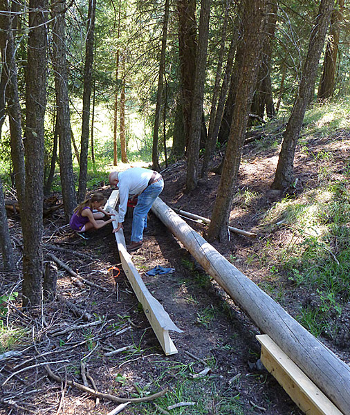 Volunteers, young and younger, building the toadlet fence.  Photo: Alan Burger