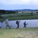 Biologists and volunteer head for the lake